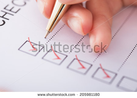 stock-photo-cropped-image-of-businesswoman-writing-on-checklist-205981180.jpg